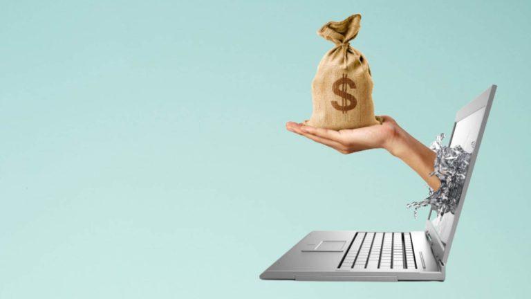 laptop handing bag of money meaning making money blogging six figure blogger